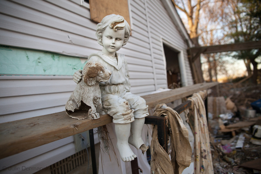 Union Beach NJ, November 16, Figurene sits on a raling of a home destroyed by superstorm Sandy's surge, that damaged over 200 homes in Union Beach alone. Hurricane Sandy's strength is being blamed on climate change by many scientists.