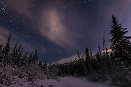 Night skies above Chugach Mountains and Eagle River Valley on winter solstice in Southcentral Alaska. Evening.