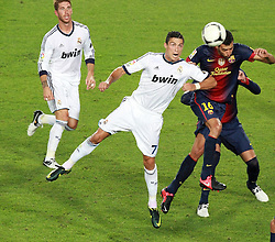 Cristiano Ronaldo scores the opening goal for Real Madrid. Barcelona v Real Madrid, Supercopa first leg, Camp Nou, Barcelona, 23rd August 2012...Credit - Eoin Mundow/Cleva Media.