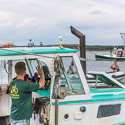 """Captain Travis Turner at the wheel of his boat """"Barbara Jean"""" at Pine Point in Scarborough, Maine."""