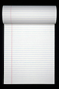 still life of lined notepad turned to empty page