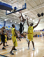 Guildford, England, Sunday 21st March 2010:  Darius Defoe of Newcastle jumps to score during the  BBL Trophy Final between Cheshire Jets and Newcastle Eagles at the Guildford Spectrum, Surrey, UK. Final score Cheshire 95-111 Newcastle.  (photo by Andrew Tobin/SLIK images)