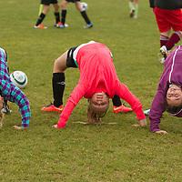 Ella Mullins, Martyna Stachurska and Cliona Stout doing gymnastics at the FAI Eflow Summer Soccer School in Lisdoonvarna