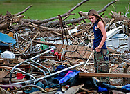 Taylor Ann Boozer walks through the rubble of a demolished home May 15, 2011 in Smithville, Mississippi. Jesse Cox, 85, died in the house, and his wife, Nell Cox, 75, was seriously injured when an EF5 tornado swept through the town on April 27, 2011. (Photo by Carmen K. Sisson/Cloudybright)
