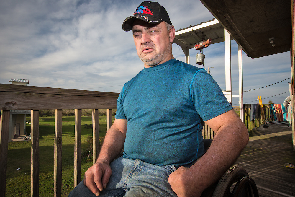 Chris Burnet o on his deck on Isle de Jean Charles.