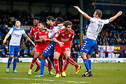 Swindon Town defender Raphael Rossi Branco (29) has a hold of Bury defender Leon Barnett (25)  to give away a penalty during the EFL Sky Bet League 1 match between Bury and Swindon Town at the JD Stadium, Bury, England on 11 February 2017. Photo by Simon Davies.