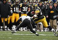 15 NOVEMBER 2008: Iowa running back Shonn Greene (23) tries to get around Purdue safety Brandon King (7) in the second half of an NCAA college football game against Purdue, at Kinnick Stadium in Iowa City, Iowa on Saturday Nov. 15, 2008. Iowa beat Purdue 22-17.