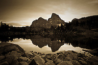 An alpine lake reflects the Grand Teton & Mt. Owen in Grand Teton National Park, Wyoming.