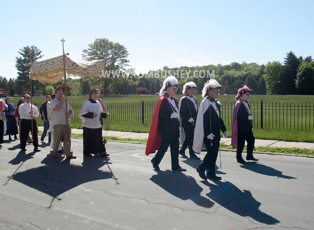 Middletown, NY - Members of the Knights of Columbus march in a procession from St. Joseph's Church down Coattage Street on the feast of Corpus Christi, May 25, 2008.