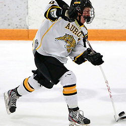 AURORA, ON - Feb 15 : Ontario Junior Hockey League Game Action between the Pickering Panthers and the Aurora Tigers, Drake Board #10 of the Aurora Tigers Hockey Club shoots the puck during third period game action.<br /> (Photo by Brian Watts / OJHL Images)