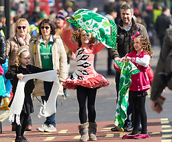 London, March 13th 2016. The annual St Patrick's Day Parade takes place in the Capital with various groups from the Irish community as well as contingents from other ethnicities taking part in a procession from Green Park to Trafalgar Square.  PICTURED: A girl dances in the street prior to the procession. &copy;Paul Davey<br /> FOR LICENCING CONTACT: Paul Davey +44 (0) 7966 016 296 paul@pauldaveycreative.co.uk