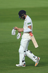 Benny Howell of Gloucestershire cuts a dejected figure as he is bowled for 40 by Michael Hogan of Glamorgan - Mandatory byline: Dougie Allward/JMP - 07966386802 - 24/09/2015 - Cricket - County Ground -Bristol,England - Gloucestershire CCC v Glamorgan CCC - LV=County Championship - Division Two - Day Three