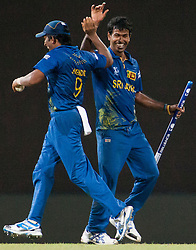 © Licensed to London News Pictures. 04/10/2012. Sri Lankans Nuwan Kulasekara and Jeevan Mendis celebrate after Sri Lanka won during the World T20 Cricket Mens Semi Final match between Sri Lanka Vs Pakistan at the R Premadasa International Cricket Stadium, Colombo. Photo credit : Asanka Brendon Ratnayake/LNP