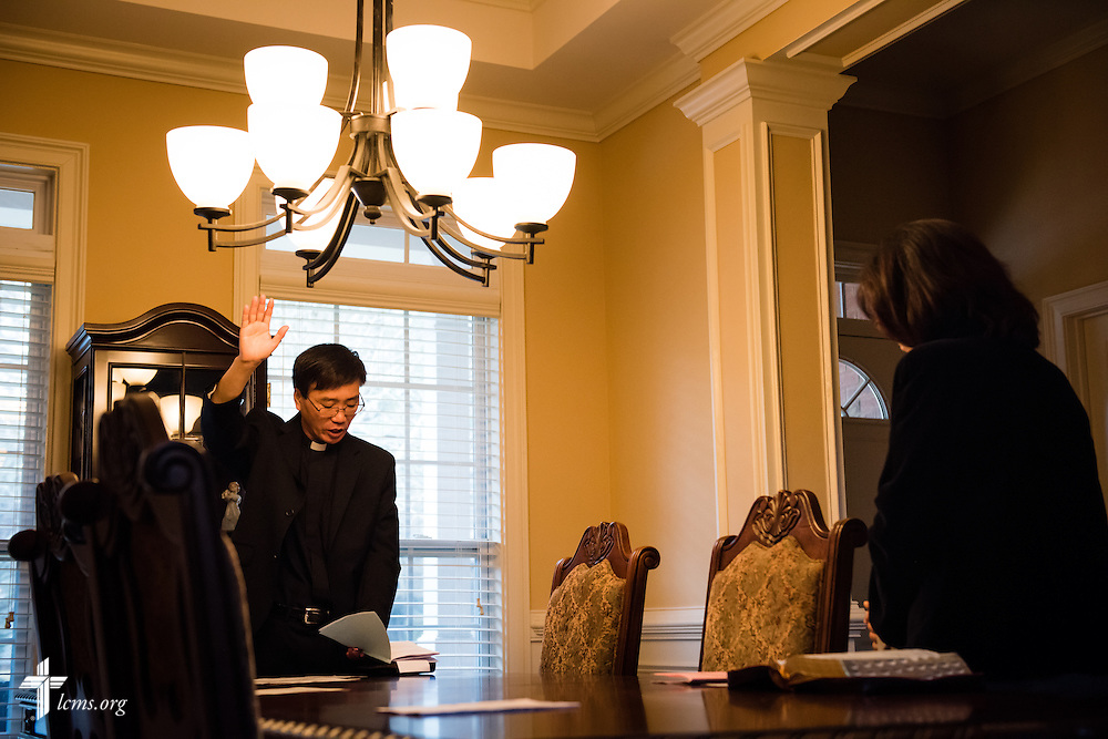 Vicar Yi Sung Chung leads worship at a home on Sunday, Nov. 23, 2014, in Duluth, Ga. His wife Gyunghea Chung (left) joins him. LCMS Communications/Erik M. Lunsford