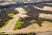 Aerial view of harvested farm fields and woods in northeast Iowa.