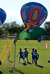 October 1, 2016 - Albuquerque, NM, U.S. - Soccer players had a delay of games at Alameda Soccer Park as balloons land in the park  during the 2016 Albuquerque International Balloon Fiesta off the fiesta grounds along El Pueblo Blvd.   Saturday Oct. 01, 2016. (Credit Image: © Jim Thompson/Albuquerque Journal via ZUMA Wire)