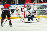 KELOWNA, BC - OCTOBER 12: Dylan Garand #31 of the Kamloops Blazers defelcts a shot by Trevor Wong #8 of the Kelowna Rockets at Prospera Place on October 12, 2019 in Kelowna, Canada. (Photo by Marissa Baecker/Shoot the Breeze)