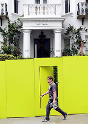 © Licensed to London News Pictures. 24/08/2012. London, UK. A man walks past a Paul Smith building. Shops and premises are boarded up today 24th August 2012 ahead of the Notting Hill Carnival which takes place this weekend.  Photo credit : Stephen Simpson/LNP