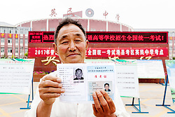 June 26, 2017 - Anyang, Anyang, China - Anyang, CHINA-June 26 2017: (EDITORIAL USE ONLY. CHINA OUT) ..Liu Yuchun, an 68-year-old man, is the oldest candidate of the National College Entrance Exam in Hua County, central China's Henan Province, June 26th, 2017. In order to receive further education and improve himself, Liu attended the exam. He got the score of 180 at the exam and would try again the next year. (Credit Image: © SIPA Asia via ZUMA Wire)