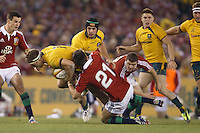 MELBOURNE, 29 JUNE - Michael HOOPER of the Wallabies is tackled by Conor MURRAY of the Lions during the Second Test match between the Australian Wallabies and the British & Irish Lions at Etihad Stadium on 29 June 2013 in Melbourne, Australia. (Photo Sydney Low / asteriskimages.com)