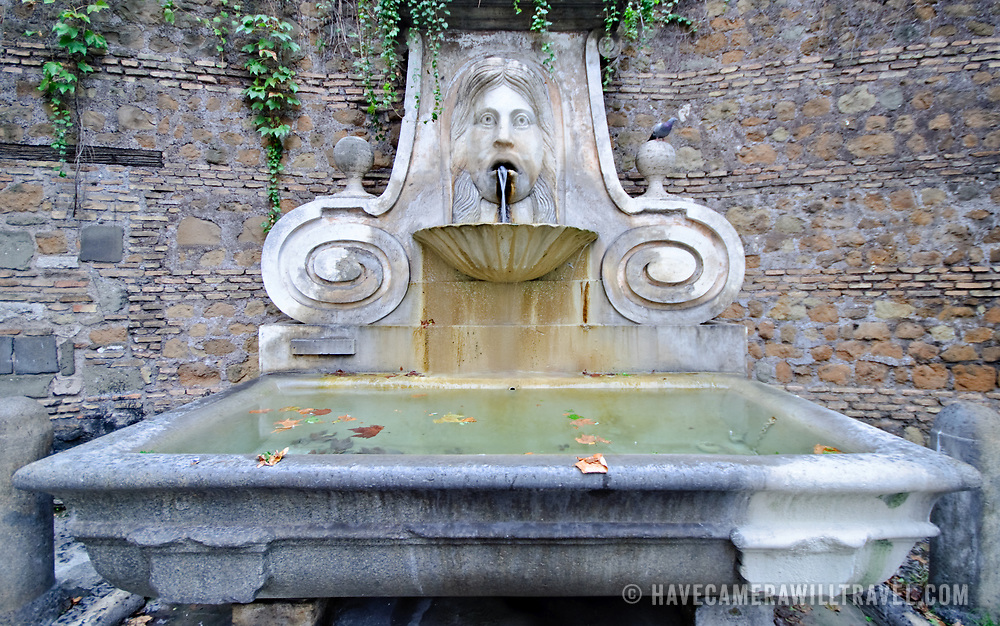 Old water fountain in Rome, Italy