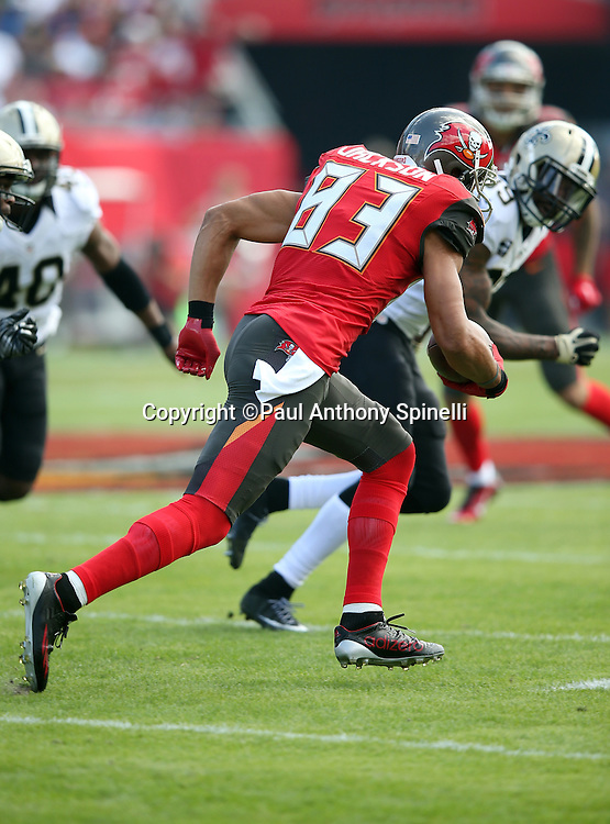 Tampa Bay Buccaneers wide receiver Vincent Jackson (83) runs with the ball after catching a pass during the 2015 week 14 regular season NFL football game against the New Orleans Saints on Sunday, Dec. 13, 2015 in Tampa, Fla. The Saints won the game 24-17. (©Paul Anthony Spinelli)