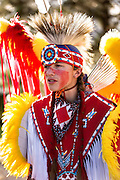 A Native American dancer from the Arapahoe people dressed in traditional costume prepares to perform a fancy dance at the Indian Village during Cheyenne Frontier Days July 25, 2015 in Cheyenne, Wyoming. Frontier Days celebrates the cowboy traditions of the west with a rodeo, parade and fair.