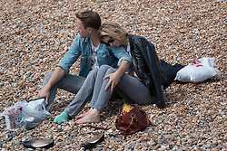 © Licensed to London News Pictures. 25/05/2014. Brighton, UK. A couple enjoy their time together on the beach. The May Bank Holiday Sunday has attracted thousands of people to visit the seaside resort and take to the beach.  Photo credit : Hugo Michiels/LNP