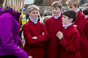 UNITED KINGDOM, Winchester: 05 March 2019 Winchester Pancake Race Photo Feature:<br /> Members belonging to the Winchester Cathedral Choir have a team talk before competition in the Inaugural Winchester Pancake Race earlier this afternoon on Shrove Tuesday. The race, which consisted of 20 teams, took place in the gardens surrounding Winchester Cathedral. <br /> Rick Findler / Story Picture Agency