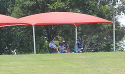 Johannesburg 20-12-18. South Africa Invitation XI vs Pakistan three-day match at Sahara Willowmoore Park, Benoni. Day 2.  A small group of cricket fans sit in the shade of a gazebo during the morning session. Picture: Karen Sandison/African News Agency(ANA)