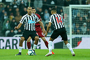 Jose Salomon Rondon (#9) of Newcastle United holds up the ball under pressure from Dejan Lovren (#6) of Liverpool during the Premier League match between Newcastle United and Liverpool at St. James's Park, Newcastle, England on 4 May 2019.