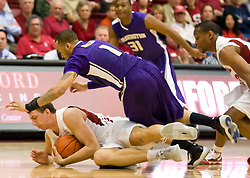 February 13, 2010; Stanford, CA, USA;  Stanford Cardinal forward Andrew Zimmermann (34) grabs a loose ball from Washington Huskies guard Venoy Overton (1) during the first half at Maples Pavilion.  Washington defeated Stanford 78-61.