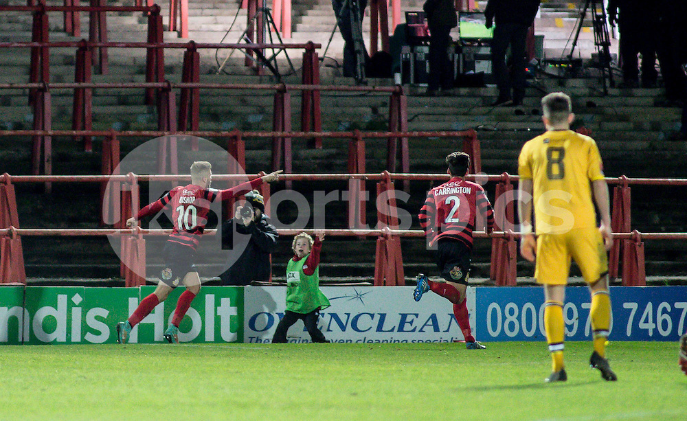 Andy Bishop of Wrexham celebrates the third goal for Wrexham during the The FA Cup second round match between Wrexham and Maidstone United at the Racecource Ground, Wrexham, Wales on 6 December 2014. Photo by Liam McAvoy.
