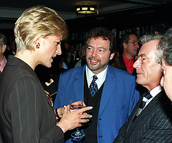 File photo dated 15/10/96 of photographer Terry O'Neill (right) with Diana, the Princess of Wales, and TV presenter Jeremy Beadle (centre) at a book launch at Harrods in London. Photographer Terry O'Neill, who rose to fame with his work with the Beatles and The Rolling Stones, has died at the age of 81 at his home on Saturday following a long illness.