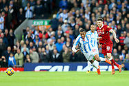 Alberto Moreno of Liverpool (r) trips Rajiv van La Parra of Huddersfield Town as they chase the ball. Premier League match, Liverpool v Huddersfield Town at the Anfield stadium in Liverpool, Merseyside on Saturday 28th October 2017.<br /> pic by Chris Stading, Andrew Orchard sports photography.