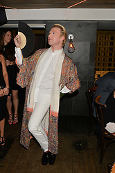 HENRY CONWAY at the launch of Geisha at Ramusake hosted by Piers Adam and Marc Burton at Ramusake, 92B Old Brompton Road, London on 11th June 2015.