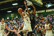 Vermont's Trae Bell-Haynes (2) leaps past Dartmouth's Wesley Dickinson (21) for a lay up during the men's basketball game between the Dartmouth Big Green and the Vermont Catamounts at Patrick Gym on Wednesday December 7, 2016 in Burlington (BRIAN JENKINS/for the FREE PRESS)
