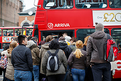 © Licensed to London News Pictures. 24/03/2016. London, UK. Commuters queuing for buses outside Wood Green station in north London as Piccadilly Line tube drivers' strike action shuts down the entire underground line on Thursday, 24 March 2016 in London. Photo credit: Tolga Akmen/LNP