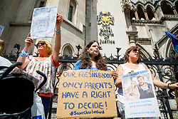 © Licensed to London News Pictures. 10/07/2017. London, UK. Pro-Charlie Gard supporters wait for Connie Yates and Chris Gard to arrive at The High Court in London on 10 July 2017. The parents of terminally ill Charlie Gard have returned to the High Court in light of new evidence relating to potential treatment for their son's condition. An earlier lengthy legal battle ruled that Charlie could not be taken to the US for experimental treatment. London, UK. Photo credit: Tolga Akmen/LNP