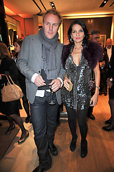 SIMON & YASMIN MILLS at a party to launch the book 'Italian Touch' - A Celebration of Italian Lifestyle held at TOD's, 2-5 Old Bond Street, London on 4th November 2009.