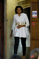 © licensed to London News Pictures. 25/05/2011. Oxford, UK. First Lady Michelle Obama entering the hall before talking to students from Elizabeth Garrett Anderson School (EGA) secondary school at Christ Church, Oxford University today (25/05/2011). The First Lady paid a surprise visit to North London school EGA while on her last visit to London in 2009. Photo credit should read: Ben Cawthra/LNP
