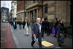 The London Mayor Boris Johnson walking past Bank on his way to Liverpool Street Station to visit Stamford Hill, London, Thursday April 5, 2012. Photo By Andrew Parsons/ i-Images...