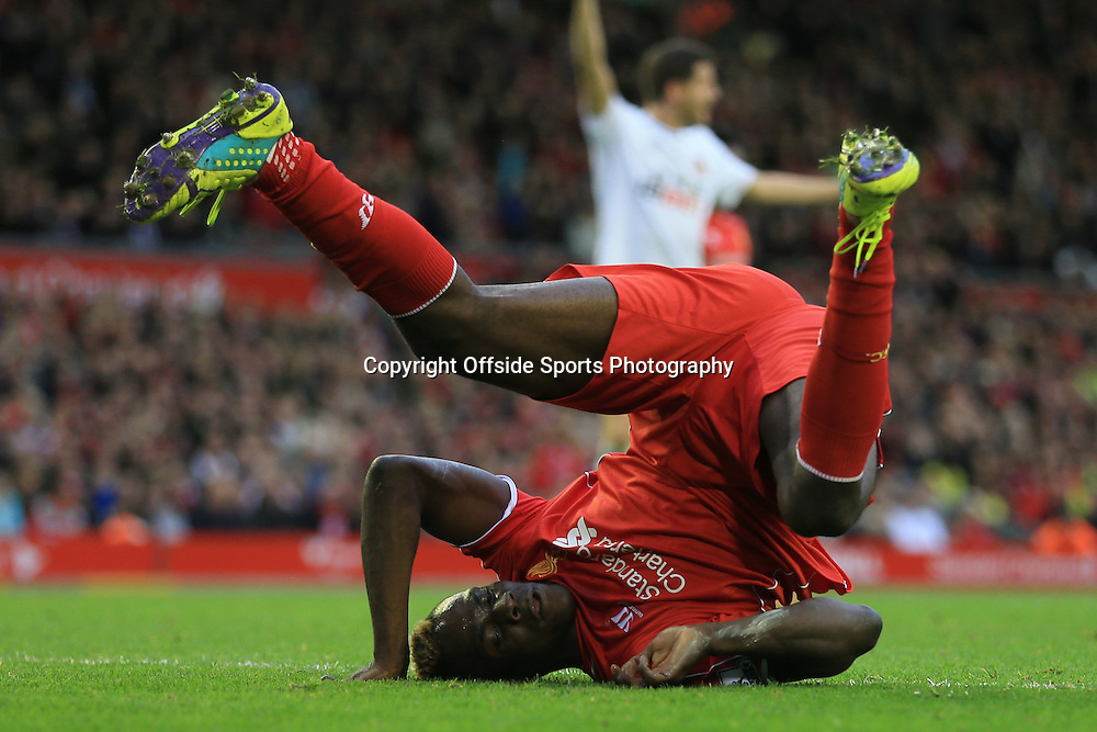 25th October 2014 - Barclays Premier League - Liverpool v Hull City - Mario Balotelli of Liverpool rolls on his back - Photo: Simon Stacpoole / Offside.