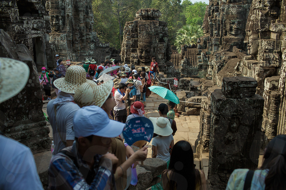 05/04/2013 - Angkor Thom (Cambodia). Around 1.12 million  tourists visited the temples of Ankgor in the first half of this year and orphanage visits have seemingly become part of the Cambodian travel experience, expecially for organized tours.© Thomas Cristofoletti 2013