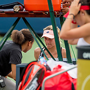 August 21, 2016, New Haven, Connecticut: <br /> Lesia Tusrenko of Ukraine receives medical treatment in action during Day 3 of the 2016 Connecticut Open at the Yale University Tennis Center on Sunday, August  21, 2016 in New Haven, Connecticut. <br /> (Photo by Billie Weiss/Connecticut Open)