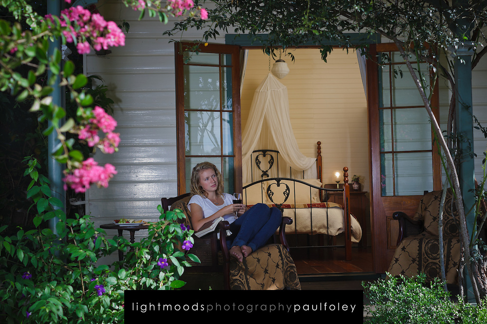 Young Woman relaxing on the Verandah of a B&B, Maitland, Australia