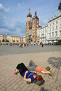 Poland, Krakow. Rynek Glówny (Market Square). St Mary's Church.