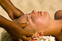 Woman getting a massage on the beach, Vatulele Island Resort, Fiji Islands
