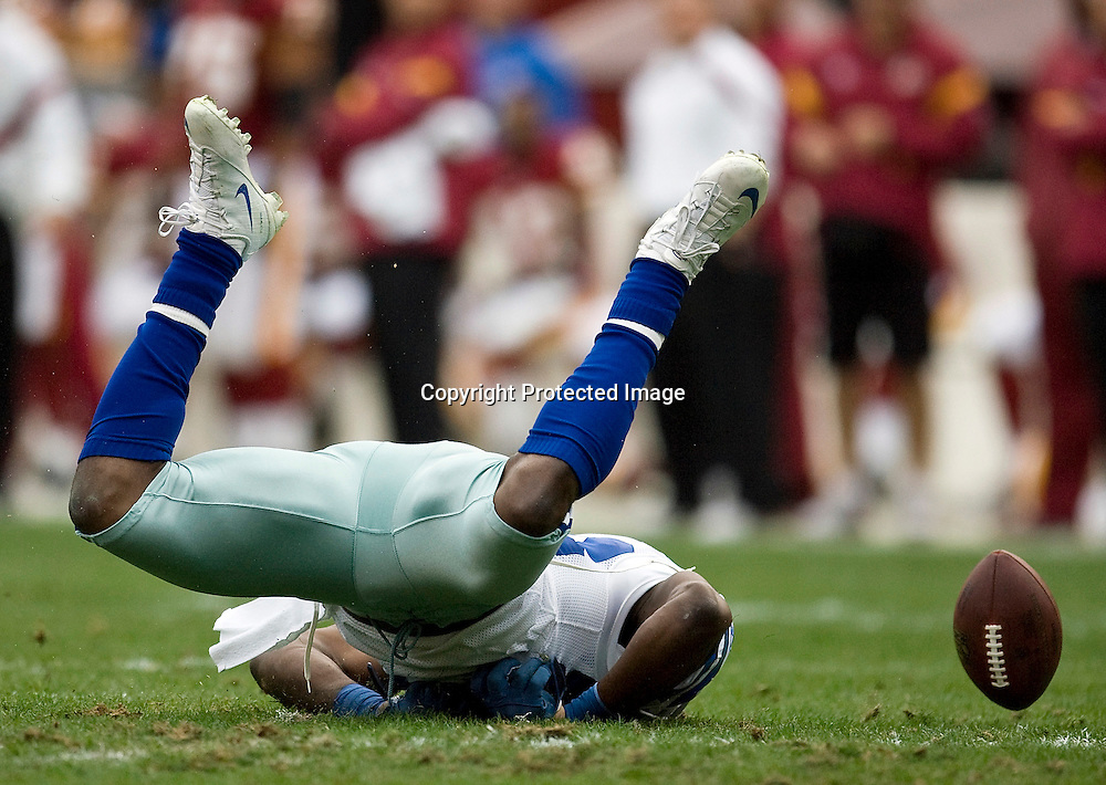 Dallas Cowboys' receiver Dez Bryant (88) hits the ground hard after he was unable to make a catch against the Washington Redskins during the first half of their NFL football game in Landover, Maryland, November 20, 2011. REUTERS/Jonathan Ernst   (UNITED STATES - Tags: SPORT FOOTBALL TPX IMAGES OF THE DAY) - RTR2U9DP
