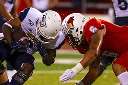 NORMAL, IL - September 21: Tuvone Clark meets up aith Lumberjack ball carrier Nate Stinson during a college football game between the ISU (Illinois State University) Redbirds and the Northern Arizona University (NAU) Lumberjacks on September 21 2019 at Hancock Stadium in Normal, IL. (Photo by Alan Look)
